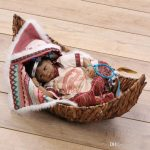American Indian Baby in canoe