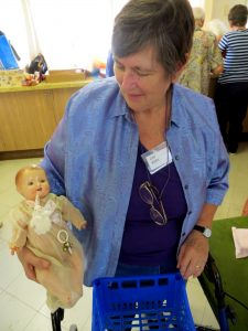 Lyn R with her 'baby doll' - 1st Prize Monthly Comp